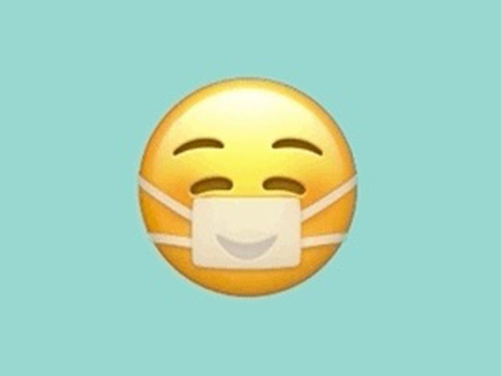 Masked smiley emoji